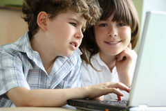 Kids learning. Yong girl and boy learning in classroom Royalty Free Stock Photo