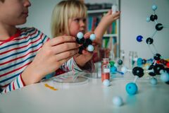 Kids learning chemistry, making experiments, engineering and STEM