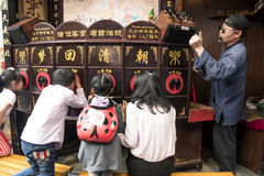 Kids learning culture, Yuyuan Gardens, Shanghai. A group of children enjoy learning about Chinese fables at Yuyuan Gardens, Shanghai China royalty free stock photography