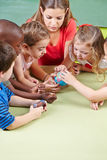 Kids learning geography. In kindergarten with a little globe stock image