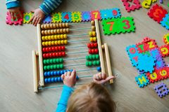 Kids learning numbers, abacus calculation Stock Photos