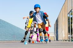 Kids learning to avoid cones at slalom course Royalty Free Stock Images
