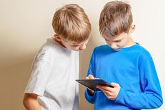 Kids learning to draw with graphic tablet and stylus pen stock photo