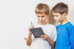 Kids learning to draw with graphic tablet and stylus pen stock images