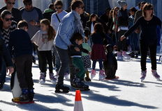 Kids learning to skate on the ice rink at Hyde Park stock photos