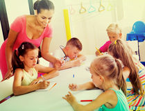 Kids learning to write on lesson in elementary school class Royalty Free Stock Photography