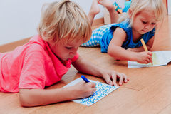 Kids learning to write numbers Stock Images