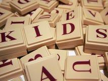 Kids Letter Tiles. Letter tiles spelling out 'kids royalty free stock photos