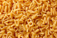 Kids letters pasta background Royalty Free Stock Photos