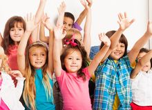 Kids lifting hands Stock Photo