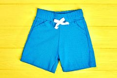 Kids light blue shorts. Royalty Free Stock Photos
