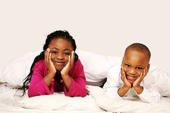 Kids listening to bedtime story. Cute happy kids listening to bedtime story Royalty Free Stock Photos