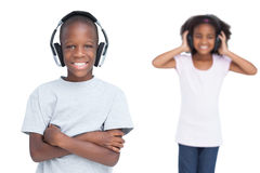 Kids listening to music with headphones Stock Photography
