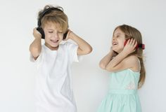 Kids listening to music. Concept Stock Image
