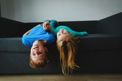 Kids- little boy and girl- have fun play at home. Family stock photography