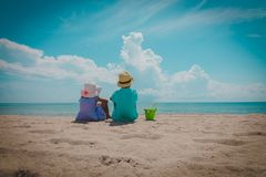 Kids-little boy and girl-play with sand on beach. Kids-little boy and girl-play with sand on tropical beach royalty free stock photo