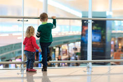 Kids -little boy and girl-waiting in the airport Royalty Free Stock Images