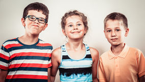 Kids little girl and boys making silly face expression. Royalty Free Stock Photography