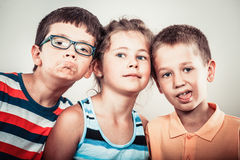 Kids little girl and boys making silly face expression. Royalty Free Stock Image