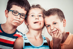 Kids little girl and boys making silly face expression. Stock Photos