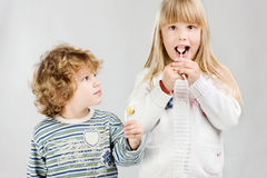 Kids and lollipop Royalty Free Stock Photos