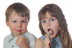 Kids with lollipops. Two 4 year old kids with lollipops Royalty Free Stock Photo