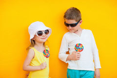 Kids with lollipops. Adorable little kids with colorful lollipops Royalty Free Stock Image