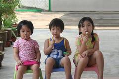 Kids & lolly pop. Kids sitting & enjoying lolly pop stock images