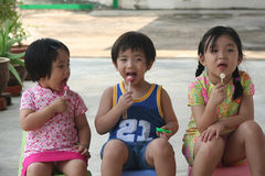 Kids & lolly pop. Kids sitting & enjoying lolly pop stock photos