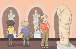 Kids looking at antique statues at museum Royalty Free Stock Photos