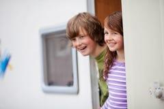 Kids Looking Away At Caravan Entrance Stock Photos
