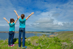 Kids looking at beautiful sea view. Family hiking on vacation Royalty Free Stock Photos