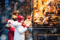 Kids looking at candy and pastry on Christmas market Stock Images