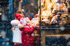 Kids looking at candy and pastry on Christmas market Royalty Free Stock Image