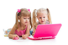 Kids looking at the laptop. Kids friends looking at the laptop Royalty Free Stock Photo