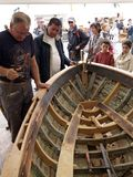 Kids looking at old wooden boat restoration Royalty Free Stock Photos