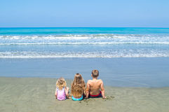 Kids looking at the sea Stock Image