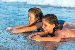 Kids looking for shells on beach. Stock Image