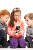 Kids looking at smartphone. Together. On white Stock Photography