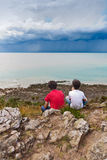 Kids Looking at a Storm stock photo