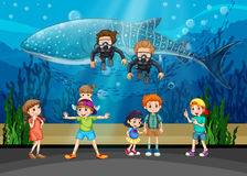 Kids looking at whale and divers in aquarium Stock Photography