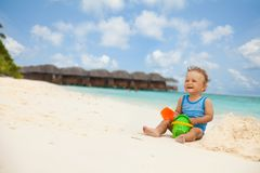 Kids love ocean and vacation Stock Images