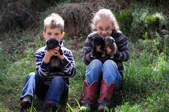 Kids Love Puppies Stock Images