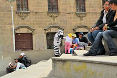Kids love the Zebra costumed workers, who help Royalty Free Stock Photos