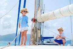 Kids at luxury yacht. Kids enjoying sailing on a luxury catamaran or yacht Stock Images