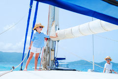 Kids at luxury yacht Stock Photos