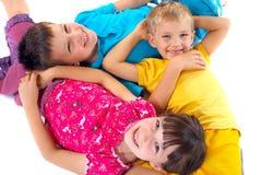 Kids lying on the floor Stock Image