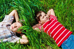 Kids lying on grass Stock Photography