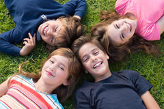 Kids lying on grass Royalty Free Stock Image