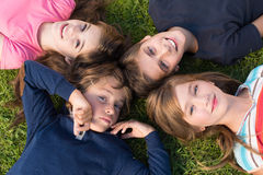Kids lying on grass Stock Photo